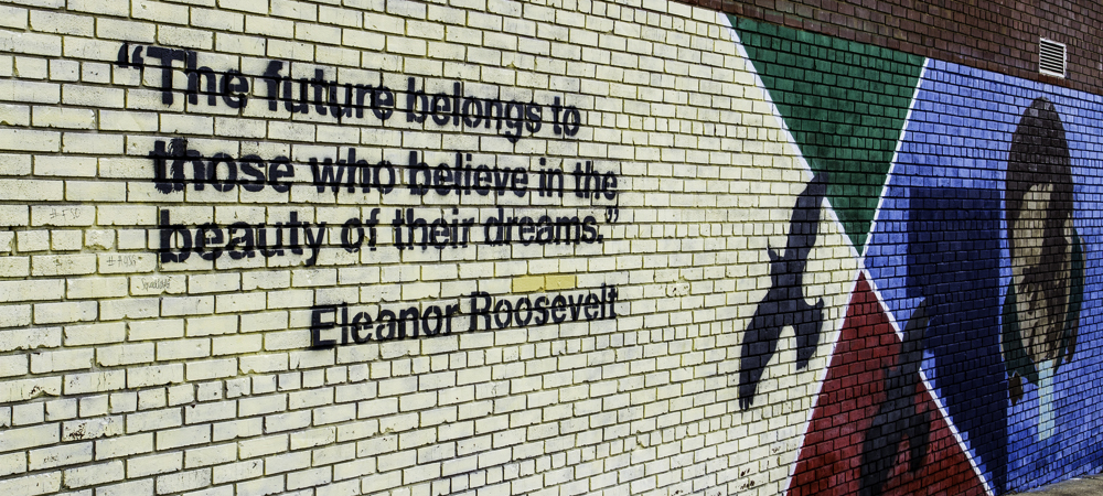 Quote by Eleanor Roosevelt written on brick wall.