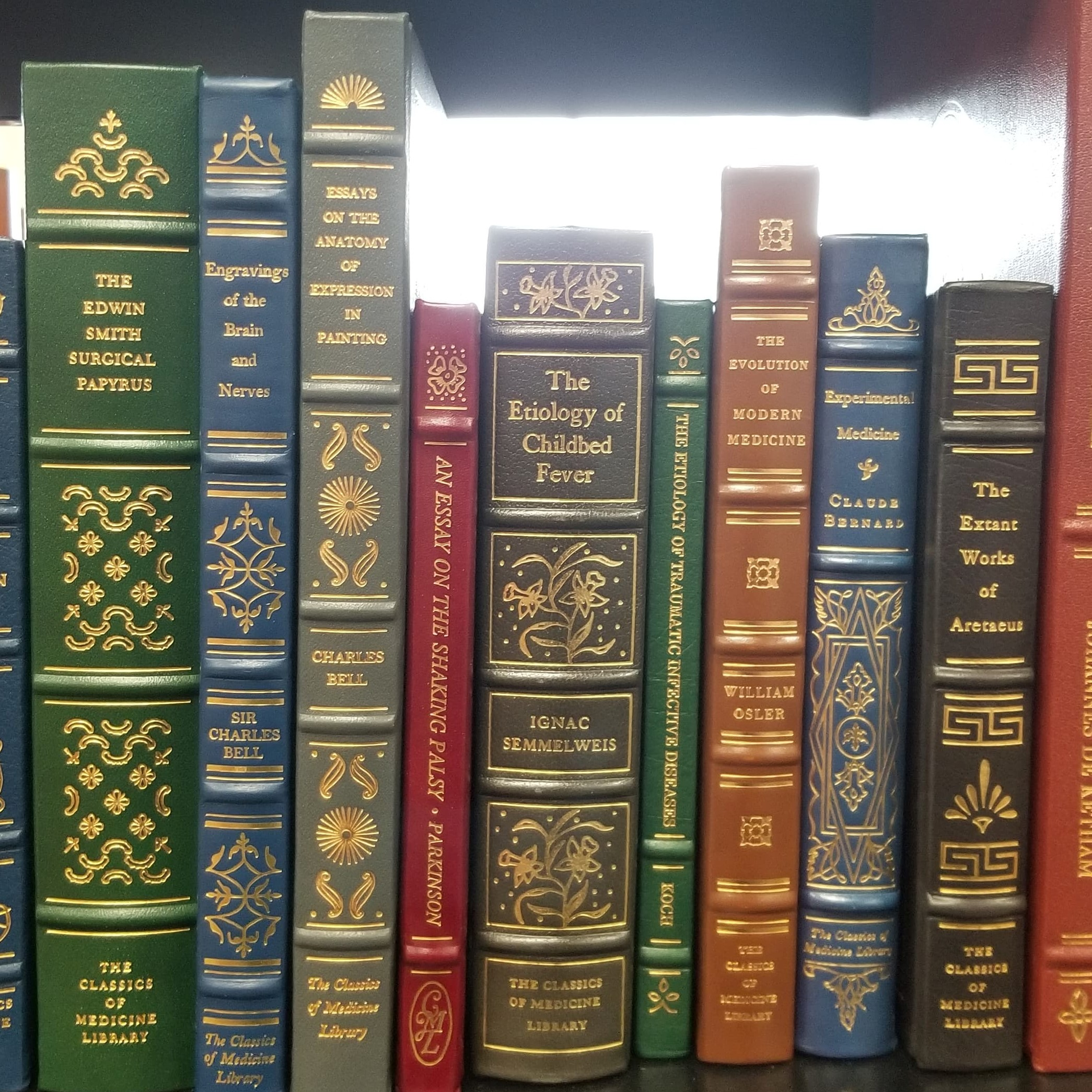 Row of colorful books from the Classics of Medicine Library.