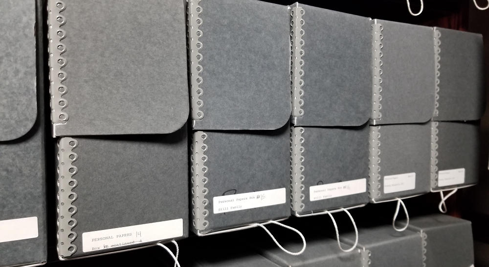 "A row of archival boxes labeled ""Personal Papers"""
