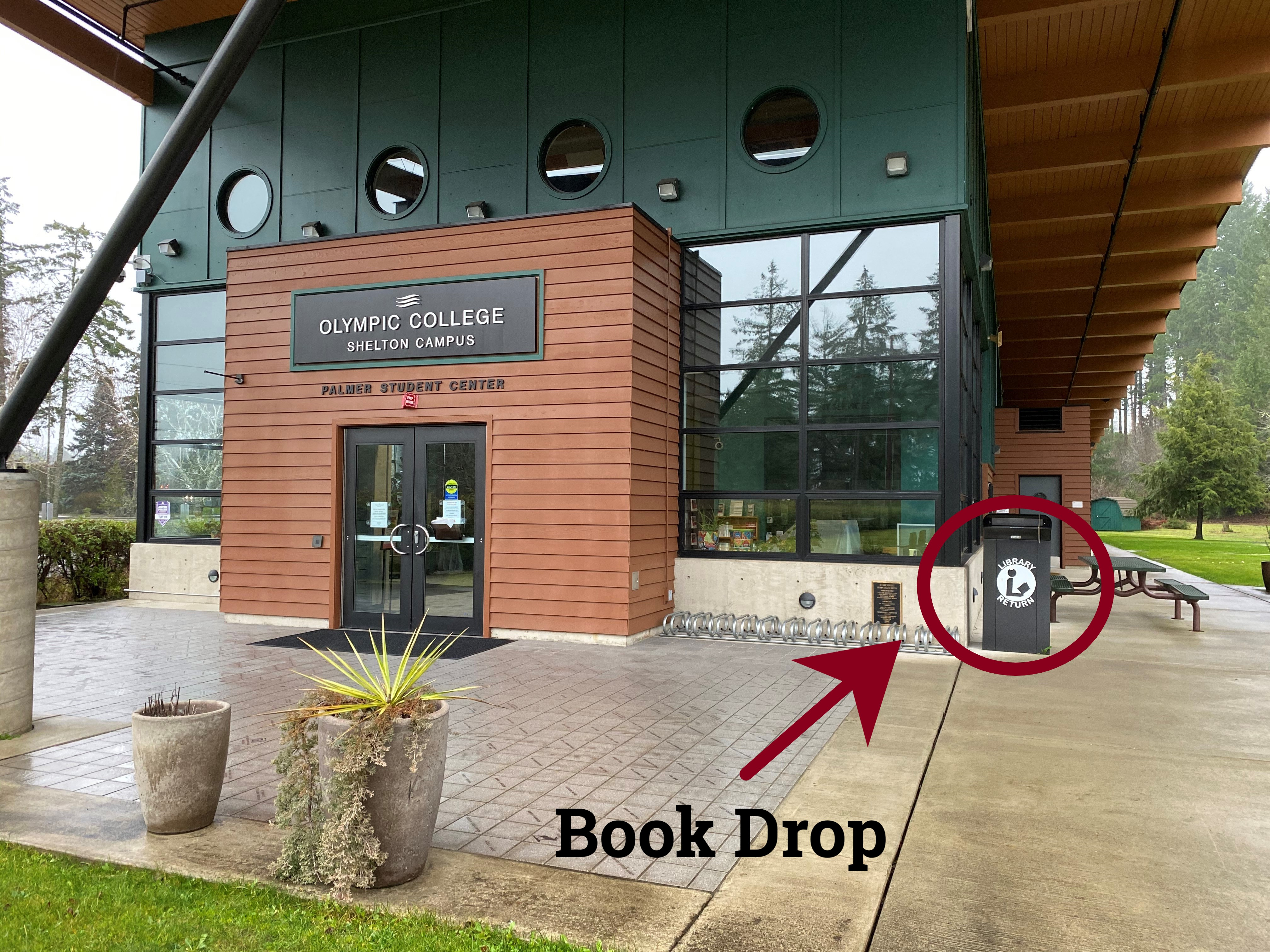 Exterior of the Shelton campus Palmer Student Center with the book drop highlighted