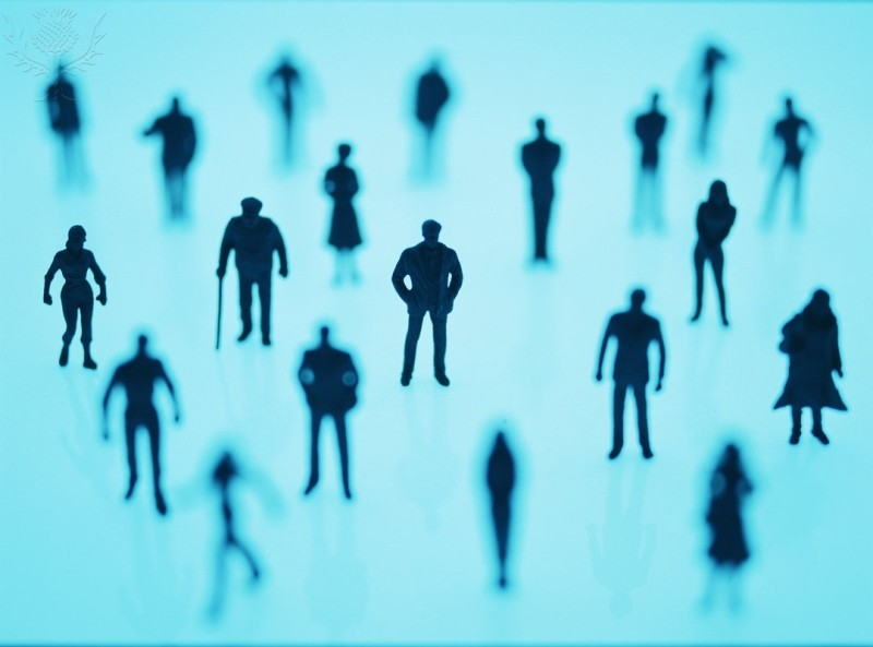 Images of human silhouettes on a teal background