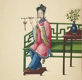 """Woman seated on a long green bench, playing a dizi."""