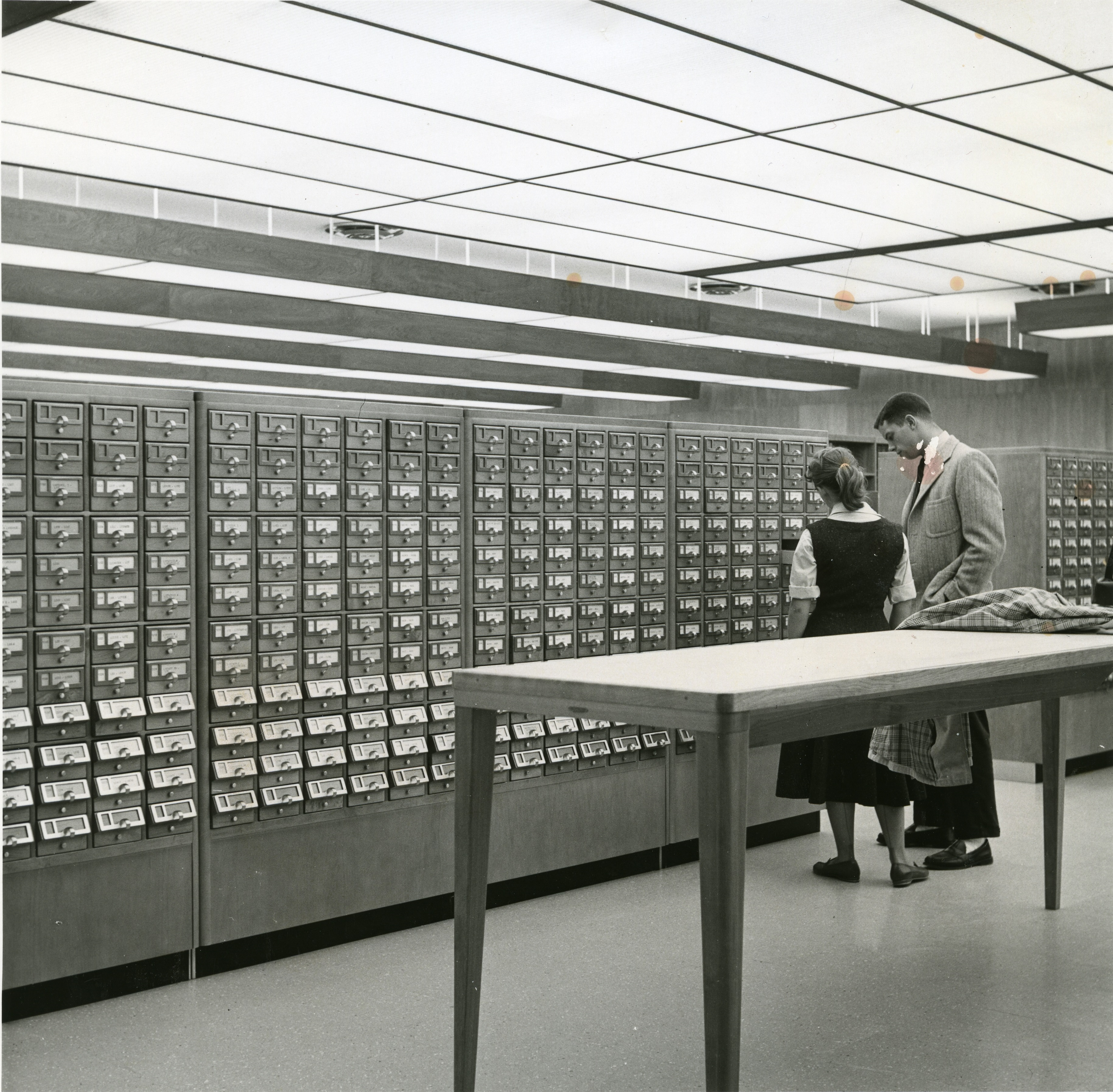 Students and a card catalog, undated.