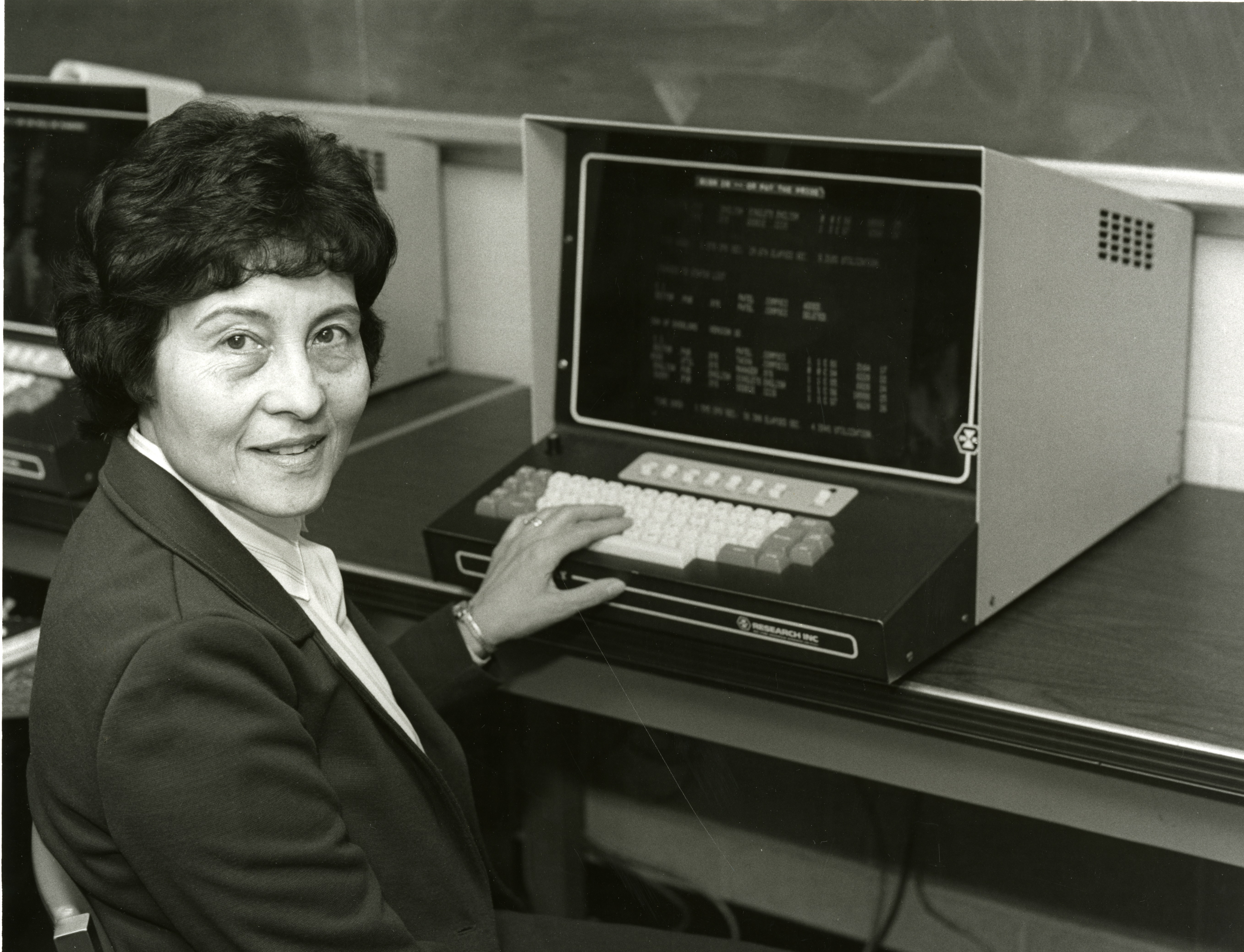 Staff with an early computer, circa 1980s.