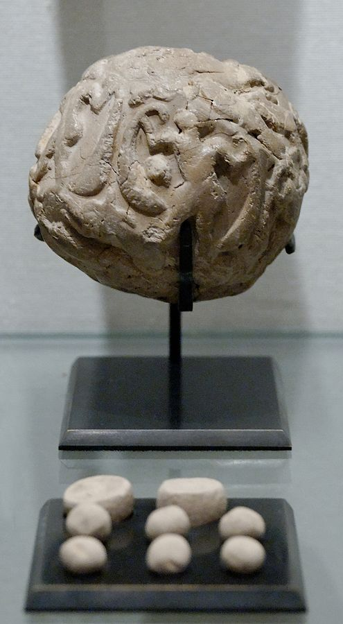 Globular envelope with a cluster of accounting tokens. Clay, Uruk period.