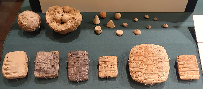 Clay accounting ball with calculi, counters, and evolution of cuneiform - Oriental Institute Museum, University of Chicago. Image By Daderot - Own work, CC0