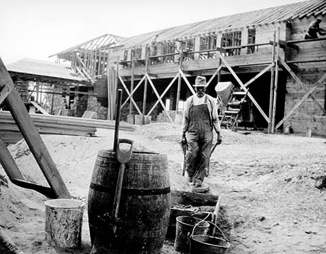 Graycliff construction from the southeast showing a workman with a wheel barrow