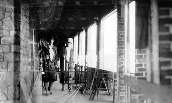 Graycliff interior under construction with two women pictured