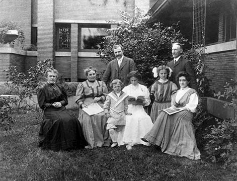 The Martin and Reidpath families posed outside the Martin House, circa 1907