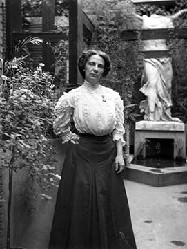 Isabelle R. Martin in the conservatory near Winged Victory statue