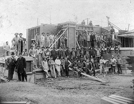Martin House construction crew posed on partially finished house, 1904