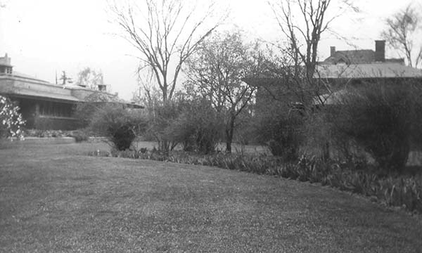 Floricycle garden with the conservatory and Barton House