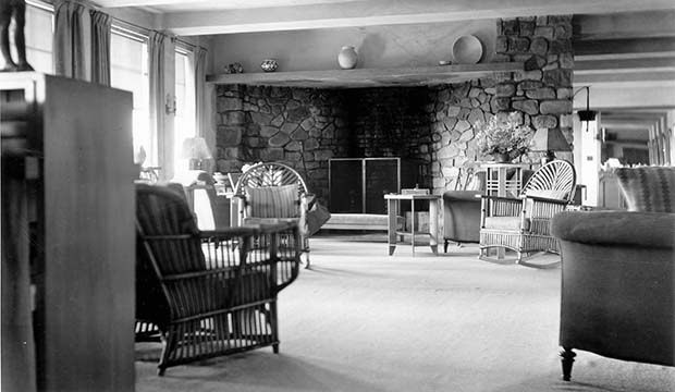 Graycliff interior showing the living room and fieldstone fireplace