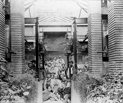 Construction crew posed in the conservatory, circa 1904