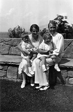 James and Dorothy Foster with children Margaret and Darwin M. sitting on the esplande stone bench