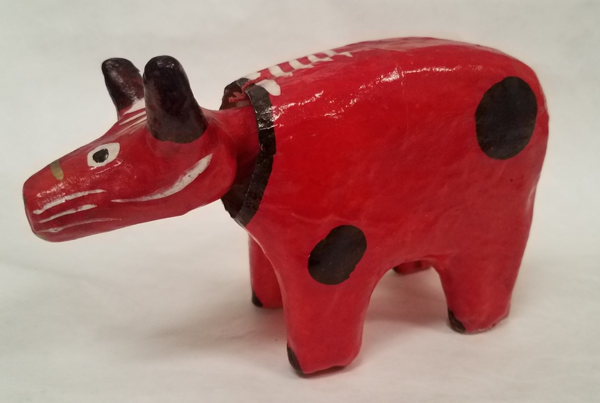 """Akabeko (Ox or Cow toy), Painted and lacquered papier-mâché, 3 ¾"""" H x 5 ְ⅝"""" W x 1 ⅞"""" D, Fukushima, Japan, 2828, Seton Hall University Museum of Anthropology and Archaeology Collection"""