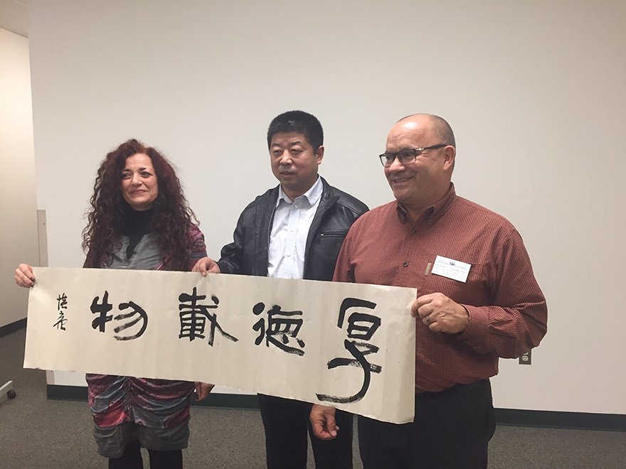 Gallery Director Jeanne Brasile, Calligrapher Peiliang Zheng, and Director of the Museum Professions Program Greg Stevens