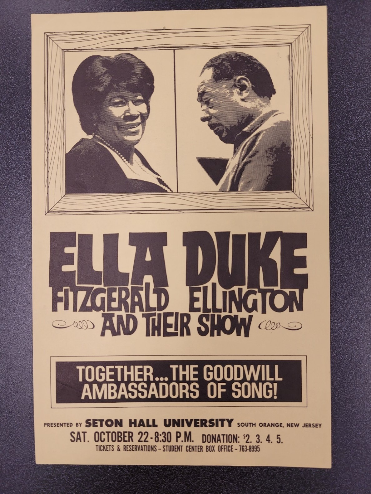 Poster with tan colored paper and brown text advertising a performance by Ella Fitzgerald and Duke Ellington with their images
