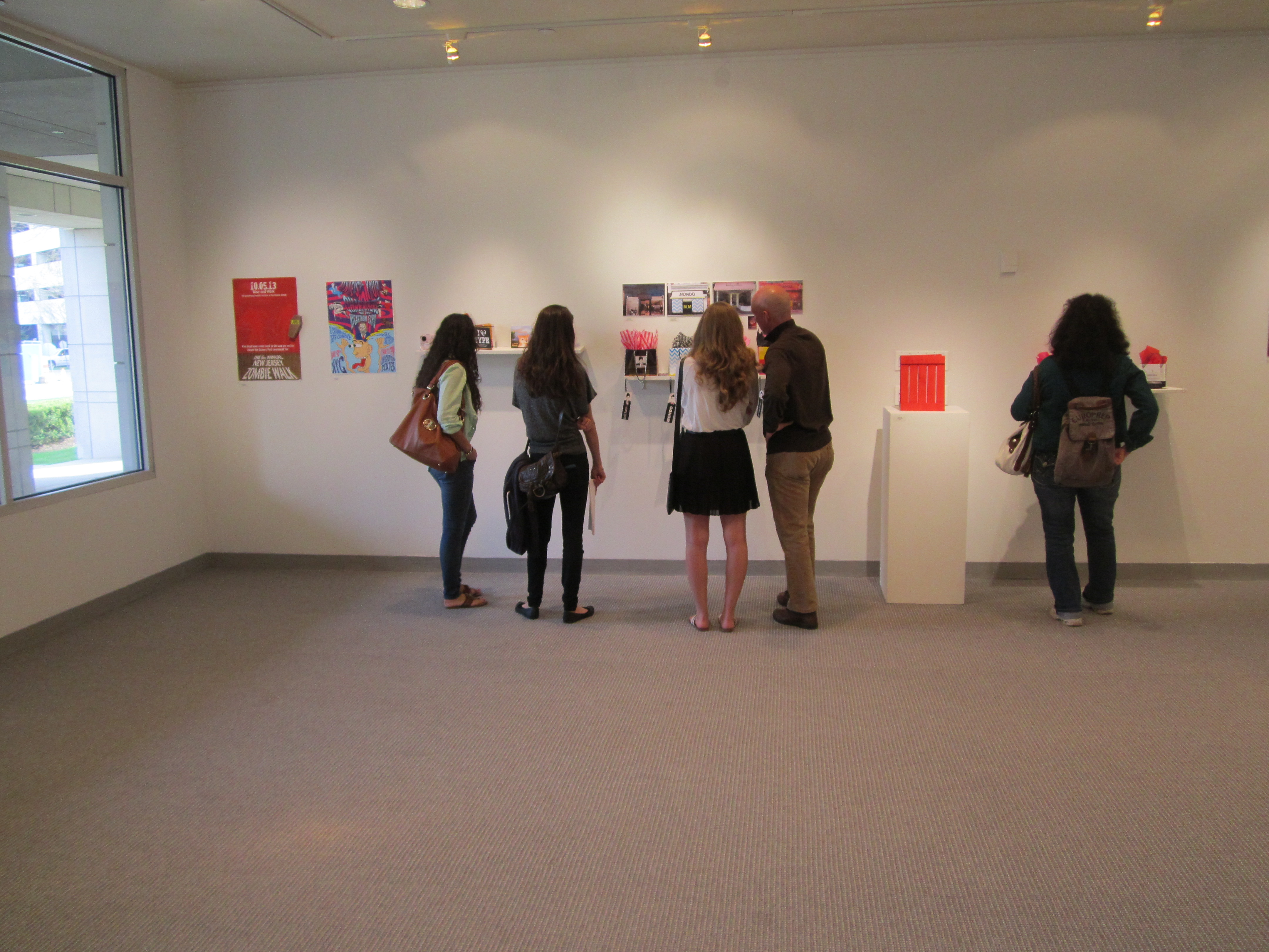 Student Exhibition Image: people looking at artwork at a past student show