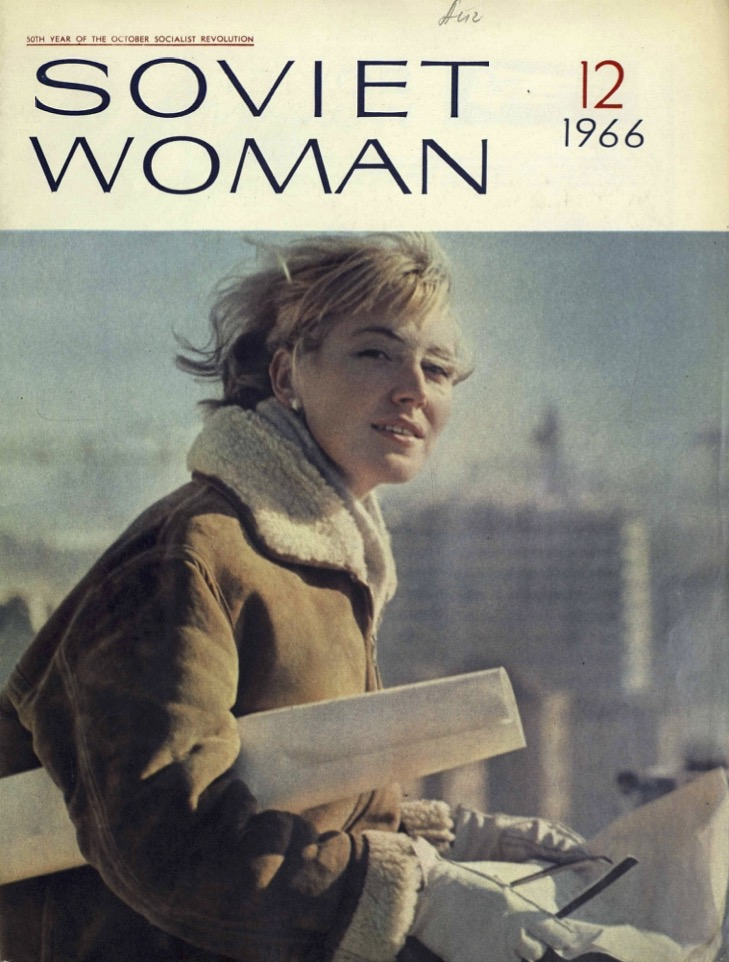Blond-haired white woman with a jacket and a slight smile