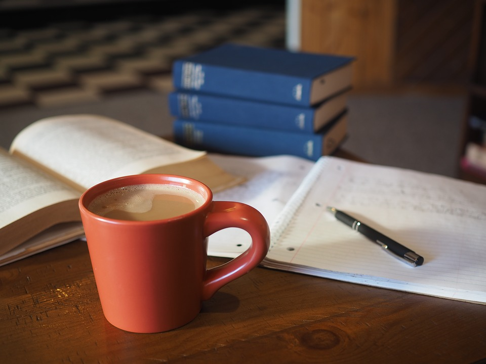 Study materials and mug of coffee