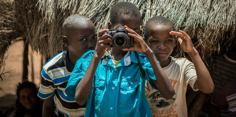 Boys looking through a camera