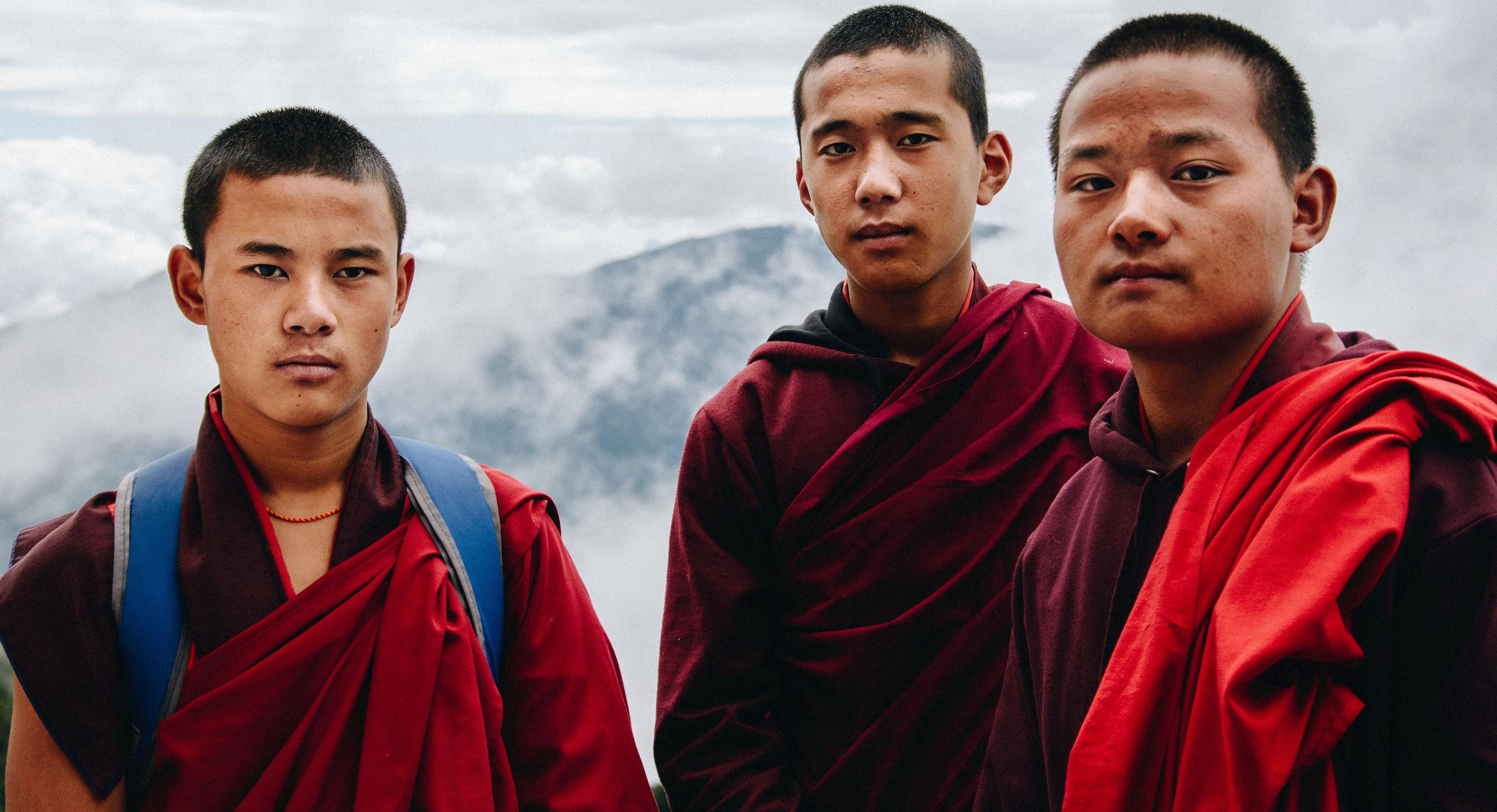 Three men standing on a mountain
