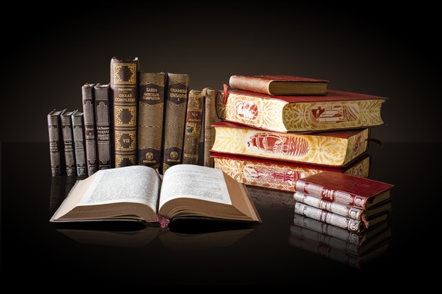Various books on dark background