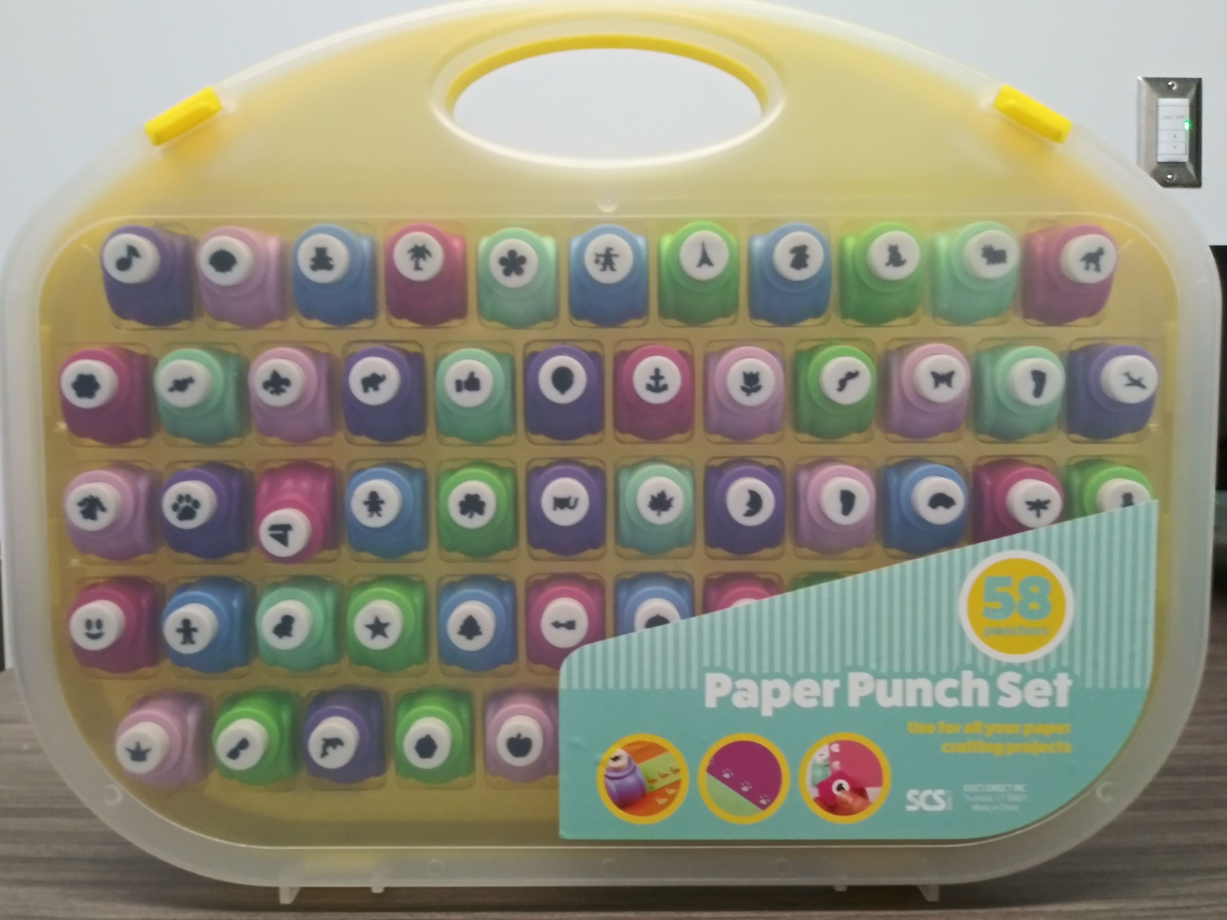 Paper punch set including 58 different punch designs