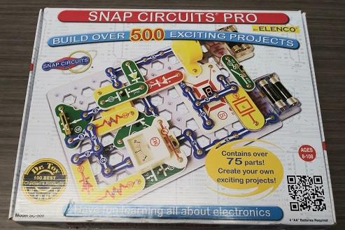 "Picture of Snap Circuits' Pro Box - featuring the text ""Build over 500 exciting projects"", and ""Contains over 75 parts! Create your own exciting projects!"""
