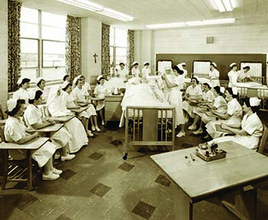 In the early to mid 1950's nursing classrooms like this one pictured in this black and white photo could be found at the north end of Founders Hall on the first floor..
