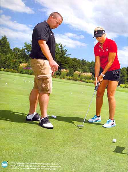 This is a color photo of Brad Duckworth and Nursing Student Devon Gorman on the golf course.