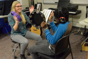 This is a color photo of a music therapy session
