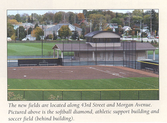Pictured in this photo is the softball diamond, ahtrletic support building and in the background, the soccer field.