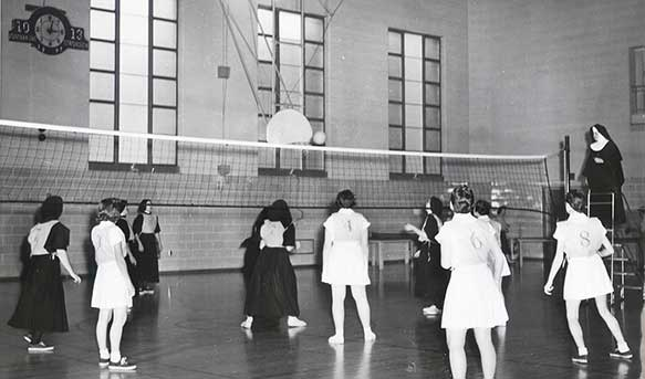 Postulants vs. Lay Students Volleyball 1955