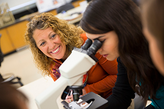 This is a color photo of faculty member Angela Frey in the lab with a student