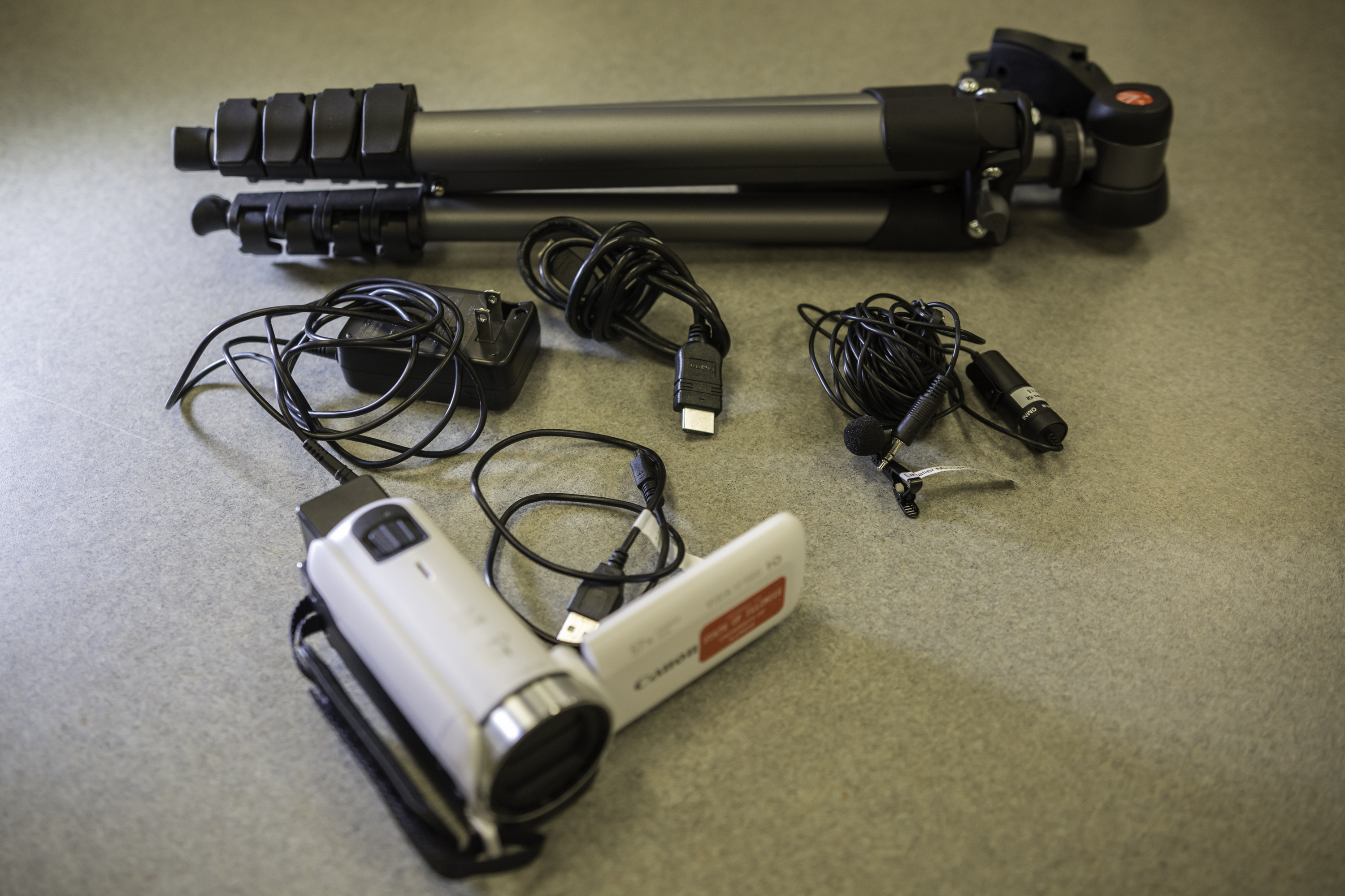 image of Canon camcorder, tripod, and lavalier