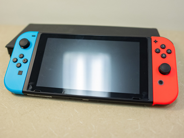 Image of a Nintendo Switch with controllers