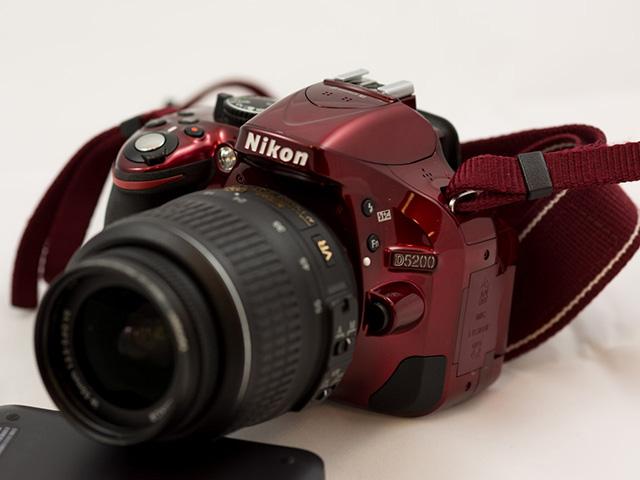 image of a red Nikon 5200 DSLR