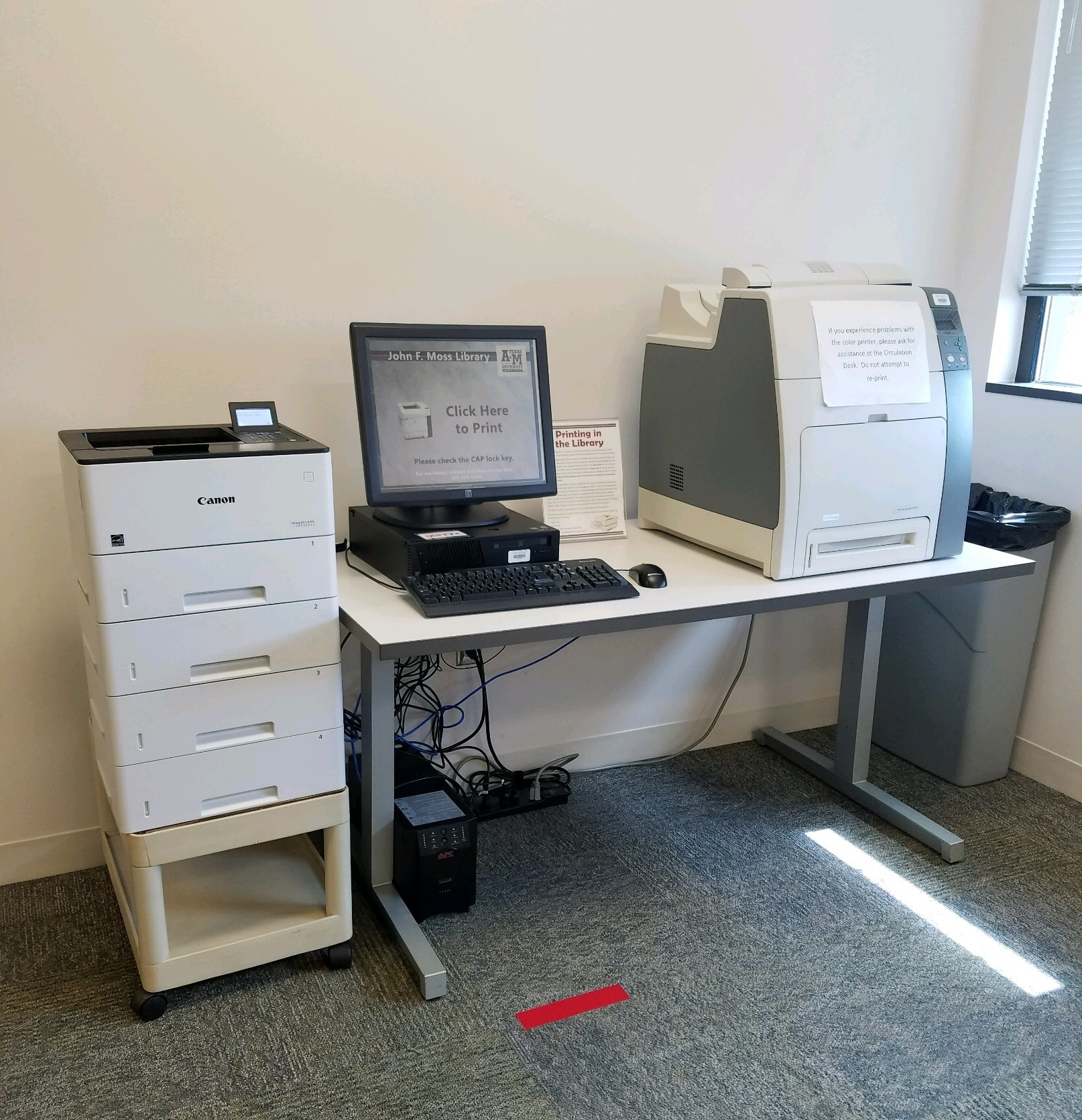 printer and monitor on desk
