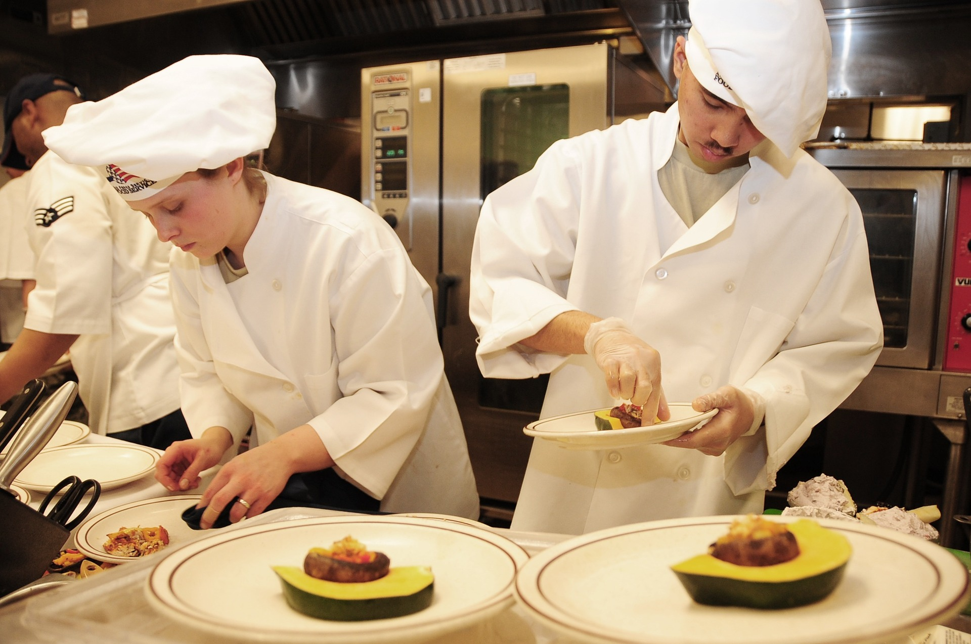 Two chefs preparing an avocado based dish