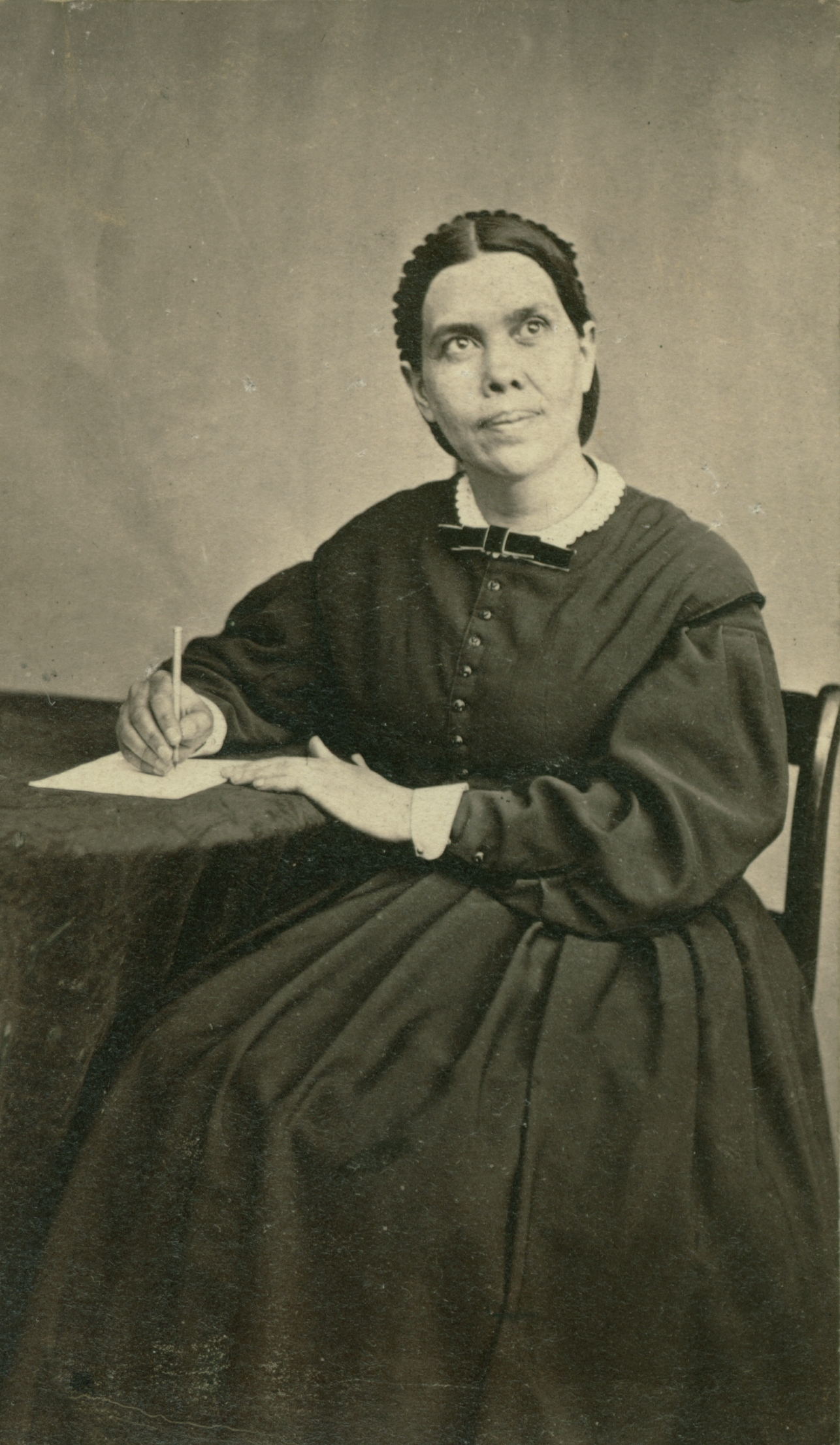 Young Ellen White at writing desk