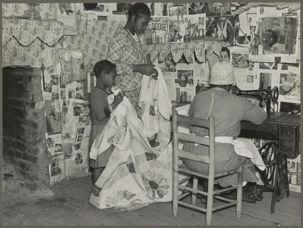 Image name Sewing a quilt. Gees Bend, Alabama, Jennie Pettway and another girl with the quilter Jorena Pettway.