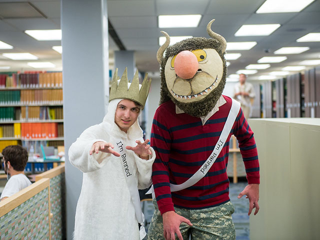 Image of theatre students dressed as Max and a wild thing from the book Where the Wild Things Are
