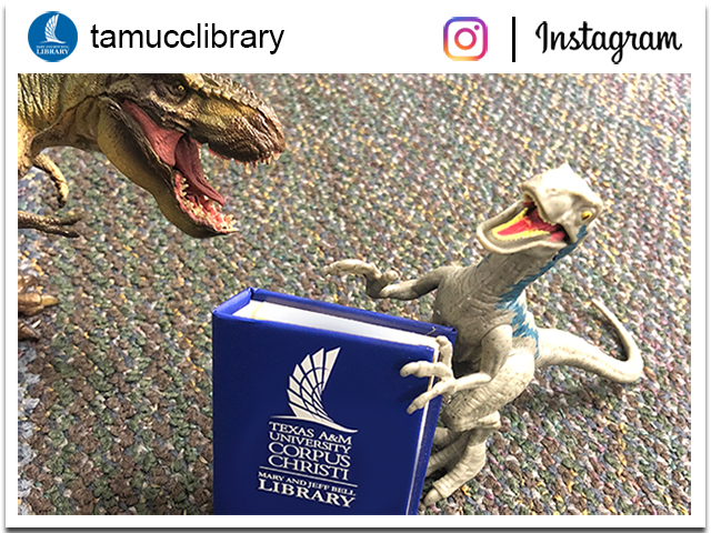 replica image of @tamucclibrary Instagram page with toy dinosaurs on carpet inside the library