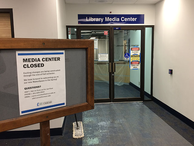 library media center doors with signs about being under construction