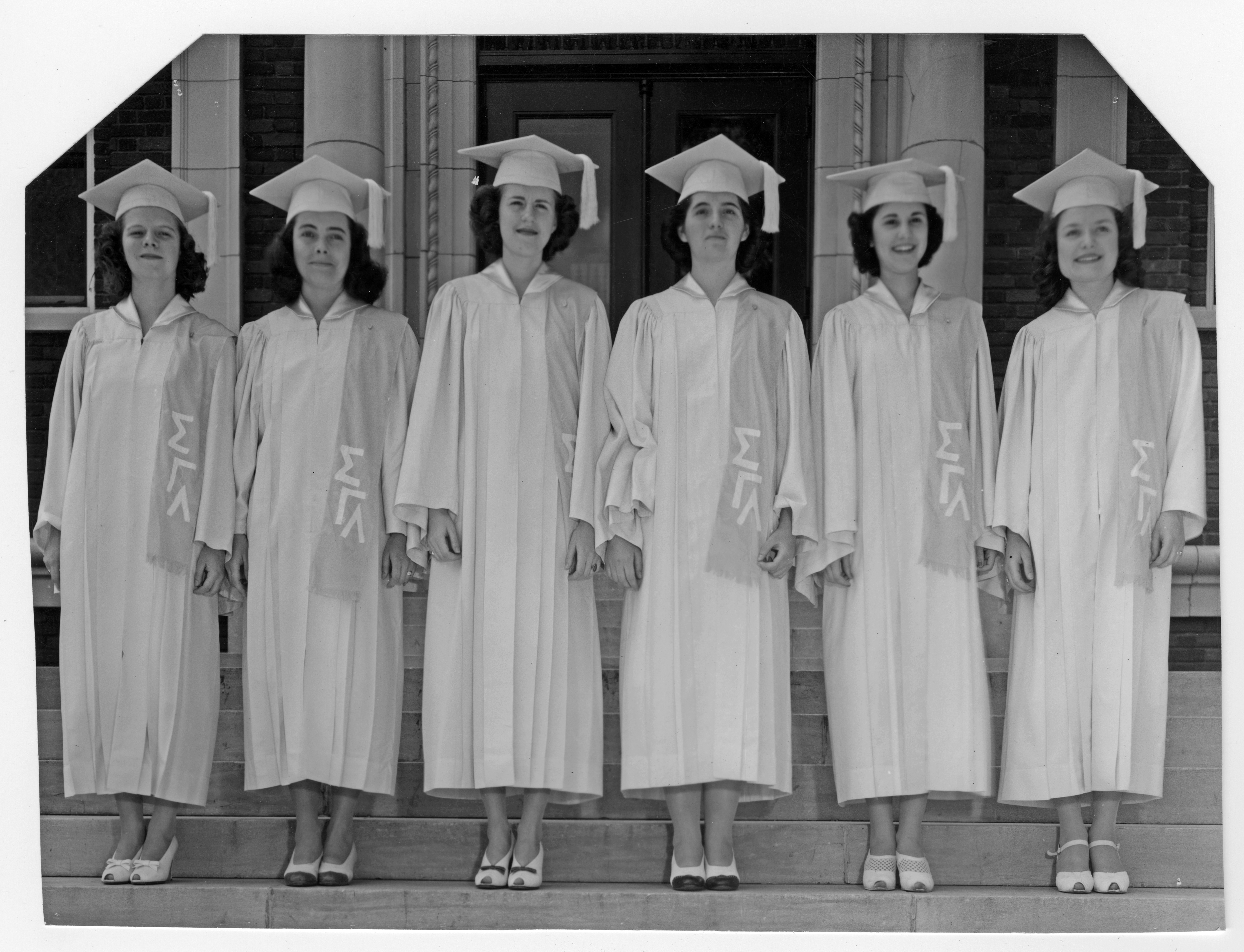 Image of Saint Mary graduates in cap and gown