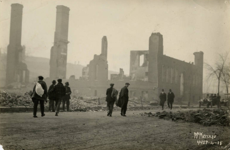 Fires of 1918 survivors walking through burnt out building (Black & White )