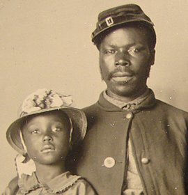 frican American soldier with wife and two daughters