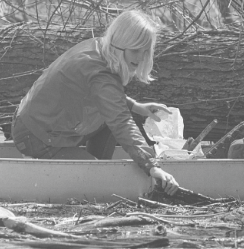 Girl scout in canoe during Earth Week